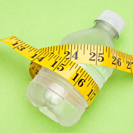 Water Bottle and Measuring Tape Health and Fitness Concept. Stock Photo - 8256022