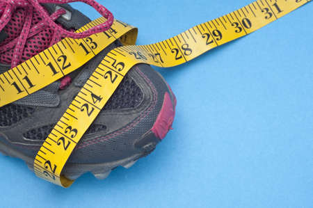 Running Shoe with Measuring Tape Health and Fitness Concept. Stock Photo - 8256075