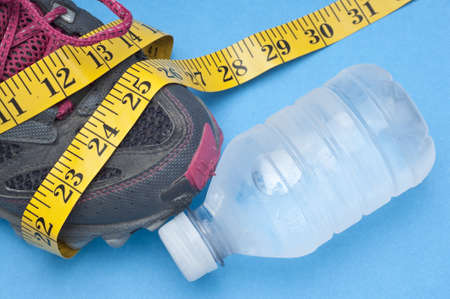 Running Shoe with Measuring Tape Health and Fitness Concept. Stock Photo - 8256051