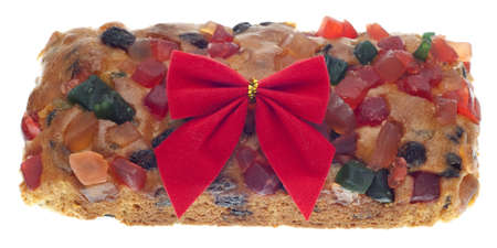 Holiday Fruit Cake Gift with a Bow Isolated on White w Standard-Bild