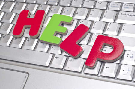 help: HELP Office Concept with Word Help on Laptop Keyboard. Stock Photo