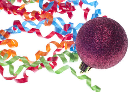 Holiday Party Concept with Streamers and Red Bauble Ornament. Imagens