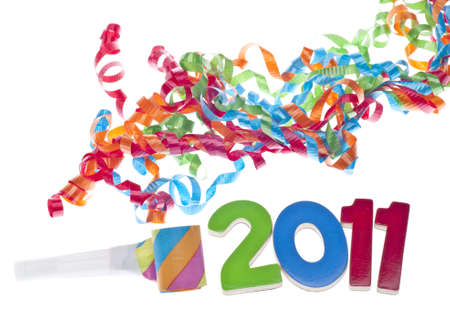 New Year Party Concept with Streamers and 2011 on White. Imagens