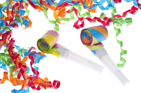New Year Party Concept with Streamers and Noise Makers on White. Imagens