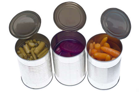 canned: Variety of Canned Vegetables in Cans Including Asparagus, Carrots and Beets Isolated on White.