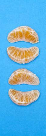 Clementine Slices on Vibrant Blue Fresh Juicy Fruit Image.