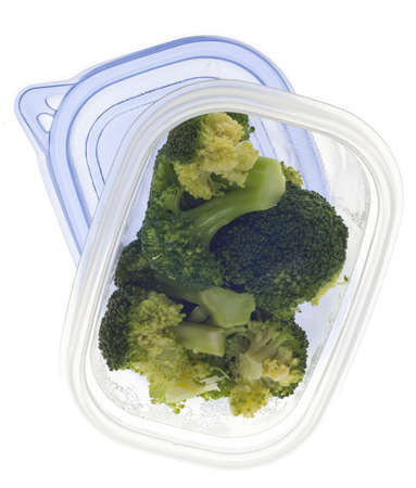 Leftover Broccoli in a Plastic Container on White. photo