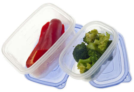 Leftover Broccoli and Red Bell Peppers Isolated on White. photo