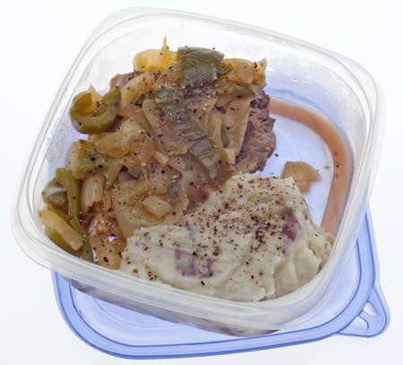 leftover: Leftover Steak with Onions and Peppers with Mashed Potatoes in a Plastic Container. Stock Photo