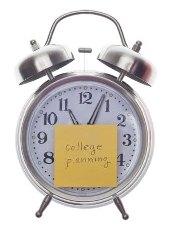 College Planning Time Concept with Note on Alarm Clock Isolated on White. photo