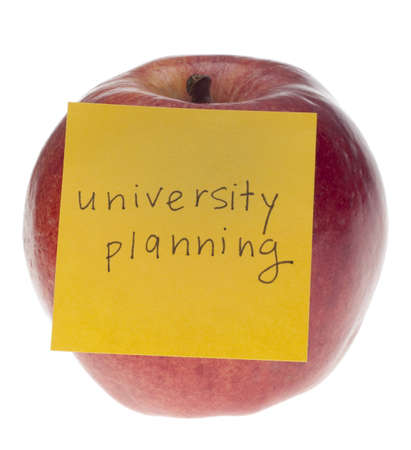 University Planning Concept with Apple and Sticky Note Isolated on White  photo