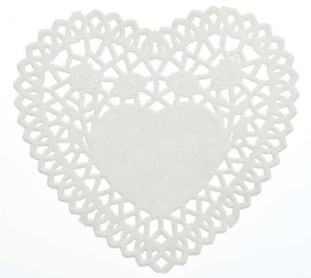 Decorative White Heart Doilie Isolated on White Фото со стока