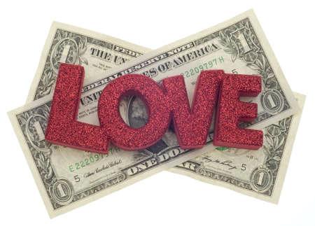 Liefde of geld kosten van liefde Concept met Amerikaanse munt geïsoleerd op wit met een uitknippad. Stockfoto