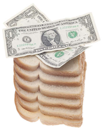 Food Budget Concept with Stack of Bread and American Currency Isolated on White