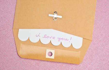 I Love You Concept with Handwritten Note in an Envelope. photo