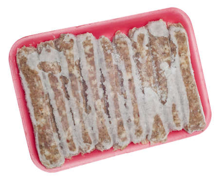 Frozen Pork Sausage Links with Frost Isolated on White photo