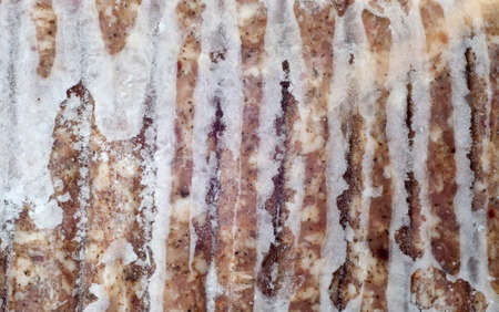 Bevroren varkensvlees worst Links met Frost voedsel achtergrond. Stockfoto