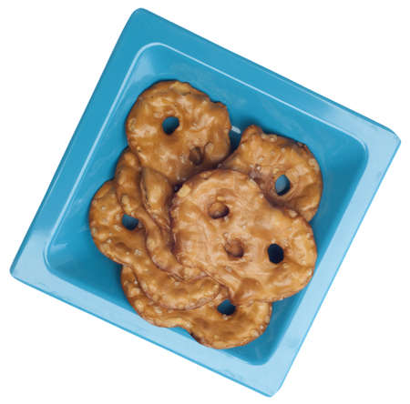 pretzel: Healthy Pretzel Toasted Chip Snack on a Blue Plate Isolated on White