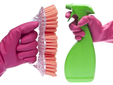 gloved: Cleaning Showdown Concept with Pink Gloved Hand, Spray Bottle and Brush.