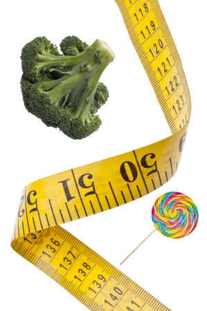 Measuring Tape Diet Health Concept with Broccoli and Candy Isolated on White photo