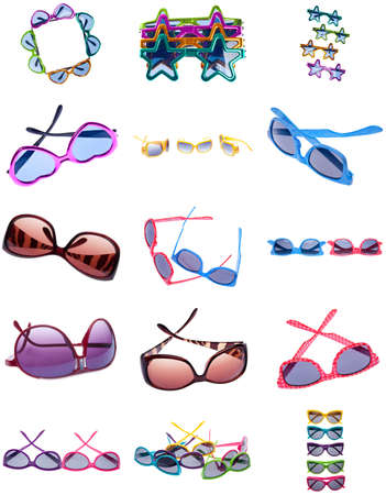 Collage Montage of Sunglasses in a Variety of Shapes and Colors Isolated on White. photo