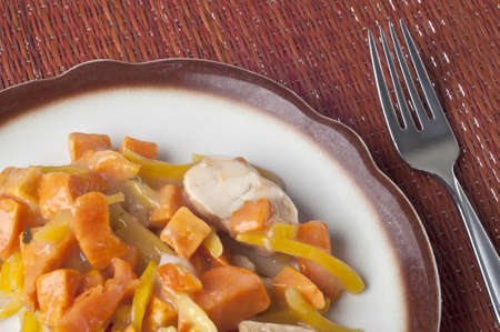 slivers: Chicken Sweet Potato and Pearl Onion Dinner with Sauce and Yellow Pepper Slivers.