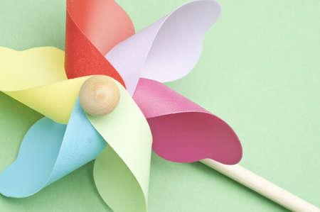 Vibrant Colorful Pastel Pinwheel on Green Background. Stock Photo - 8894776