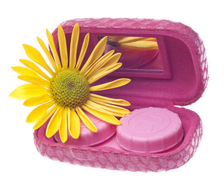 Contact Lens Case with Yellow Daisy Isolated on White with a Clipping Path. Фото со стока
