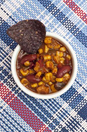 corn tortilla: Tasty Black Bean Dip with Blue Corn Tortilla Chips. Stock Photo