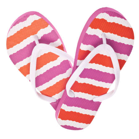 Pink and Orange Flip Flop Sandals in Heart Shape on White. photo