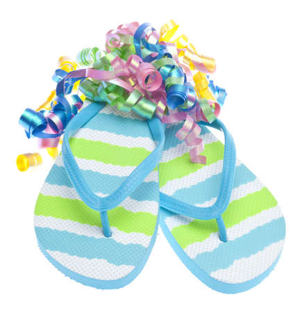 Beach Party Concept with Streamers and Flip Flop Sandals Isolated on White. photo