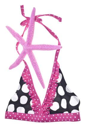 two piece bathing suit: Concepto de Bikini de verano con la parte superior de traje de ba�o y Rosa estrella de mar  Foto de archivo