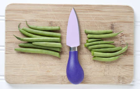 Sliced Green String Beans with Vibrant Knife Cooking Concept. photo