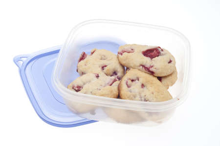 Leftover Strawberry Shortcake Cookies in Plastic Container Isolated on White. photo