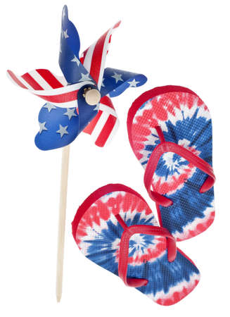 Patriotic Red, White and Blue Tie Dye Flip Flop Sandals & Pinwheel Isolated on White with a Clipping Path. photo