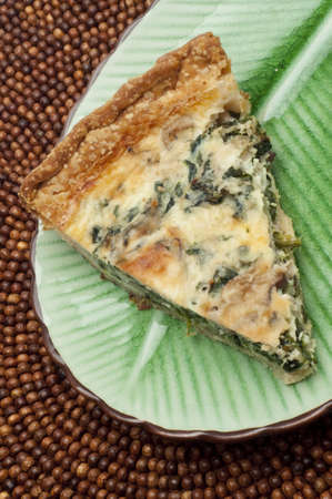 shallot: Spinach, Mushroom and Shallot Quiche on a Plate. Stock Photo