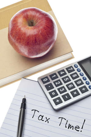 Tax Time Concept with Note on Paper with Calculator, Book and Apple. photo