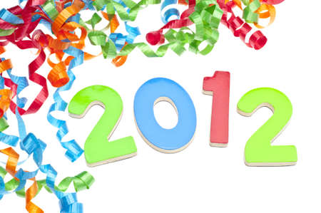New Year 2012 Concept with Year and Party Streamers on White. Imagens