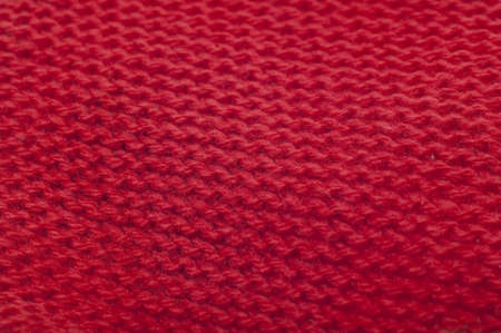Red Knit Background Texture with Focus in Center.
