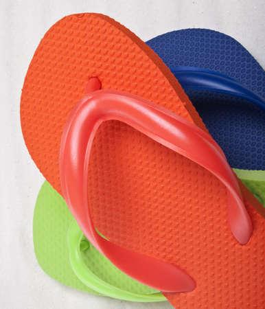 Summer Flip Flop Sandals on a Sand Background. photo