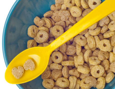 Vibrant Bowl with Breakfast Cereal Close Up with Cereal on Spoon. Stock Photo - 10301251