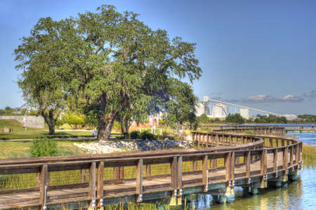 View of Industry from Riverfront Park in North Charleston, SC in HDR Style. Stock Photo