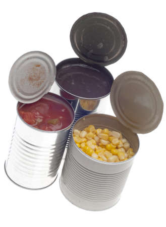 Corn, Black Beans and Tomatoes in Cans Isolated on White.