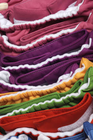 Vibrant Eco Friendly Cloth Diapers Close Up of Stack  photo