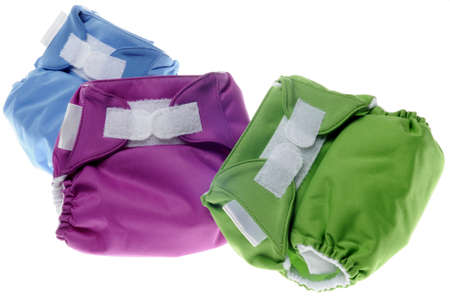 Eco Friendly Cloth Diapers in Green, Purple and Blue Isolated on White  photo