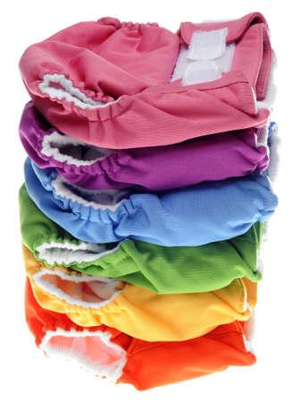 tissu blanc: Pile de Eco Couches lavables amicales sur blanc Banque d'images