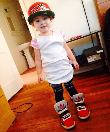 clothing: Little girl dressing up like daddy