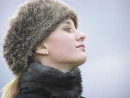 choker: Headshot of girl with fur hat and choker