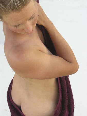 Woman in towel backside Stock Photo