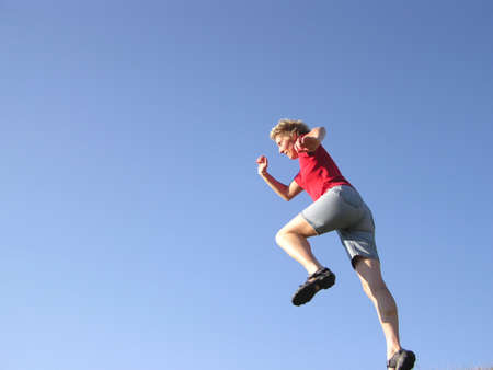 exertion: Runner with blue sky Stock Photo